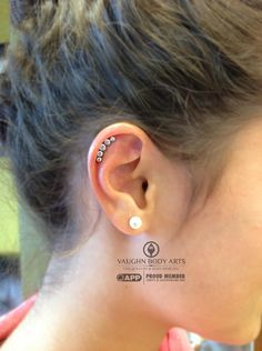 Gina has been patiently waiting to have her helix pierced, and the day finally came!  She chose one of our lovely smaller gemmed anatometal clusters filled with CZ's.  A perfect fit for her ear.  Thank you, Gina!vaughnbodyartsMonterey, CA