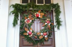 Cinnamon-colored magnolia and white quaking aspen leaves are layered to look like flowers, while pheasant feathers provide another level of texture in this wreath.