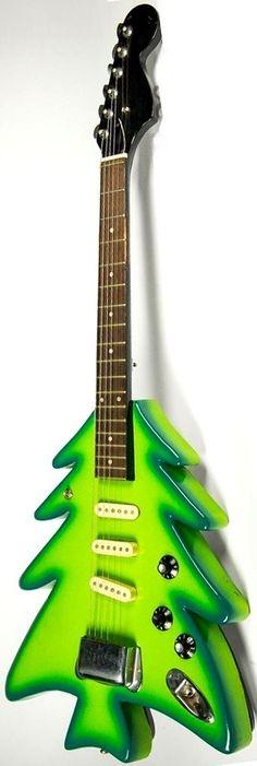Liver-Lips' Christmas tree-shaped Guitar (Care of the Walt Disney Archives) --- https://www.pinterest.com/lardyfatboy/