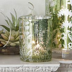 """Garden Tealight holder - $10 This glass holder has a metallic green and silver faux mercury finish highlighting a botanical motif. Use with a tealight, sold separately. 4""""h 10 cm h, 3¼""""w 8 cm w"""