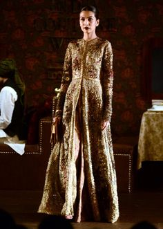 Model showcasing Golden top once piece gown for sabyasachi at Indian couture week july 2014 Sabyasachi Dresses, Floral Lehenga, Couture Collection, Bridal Collection, Indian Couture, Couture Week, Pakistani Outfits, Pakistani Bridal, Asian Fashion