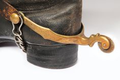 CSA General Robert E. Lee's boot and fine filigreed brass spurs, according to his nephew; who gave the spurs to the Museum of the Confederacy in Richmond, Virginia, they were part of Lee's field uniform that he used during the Civil War.