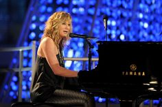 "Sugarland's Jennifer Nettles jumps behind the keys to perform ""Coming Home"" during ""The GRAMMY Nominations Concert Live!!"" on Dec. 2, 2009"