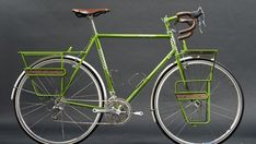 CyclingAbout – The 18 Nicest Touring Bikes in the World - Hufnagel - Jordan Hufnagel has put together this georgeous classic tourer in bespoke bike central, Portland (USA). The paint-matched stem and racks are pure class and I especially love the wooden panels that are inserted into the racks.