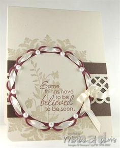 Love the ribbon laced through the diecut with the pearls!