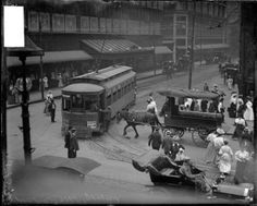The busy intersection of State and Madison Streets in 1906, which features pedestrians, a streetcar, and automobile, and horse-drawn wagon. DN-0050752