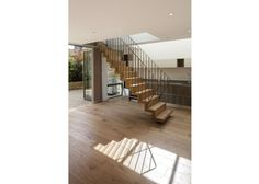 In the end house,  a bespoke steel and oak stair treads lightly.