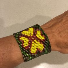 """Beaded Cuff Bracelet This floral beaded cuff bracelet has never been worn. It is about 2"""" thick and has a double closure. Jewelry Bracelets"""