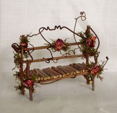 Beautiful fairy garden bench made with twigs and vines and colorful dried flower petals