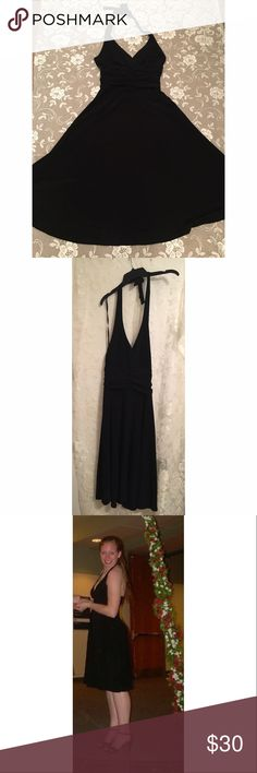 """Black Halter Top Marilyn Monroe Dress - LBD This dress is basically the design of the classic white Marilyn Monroe dress, but the fabric has some weight to it, so it'll swirl around but not fly over your head, like Marilyn's. There's rouching at the waist which really looks flattering. Size 6 but it's stretchy and could fit a size 8 pretty well. I'm 5'7"""" in the photo so you can see where the hem hits. Lovely, classic LBD, it's just not getting any wear sitting in my closet! Evan Picone…"""