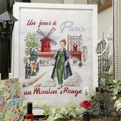 Un jour à Paris au Moulin Rouge - linen.  This site has unique patterns of women dressed in 50's glamor in scenes around Paris in different seasons.  Very nice!
