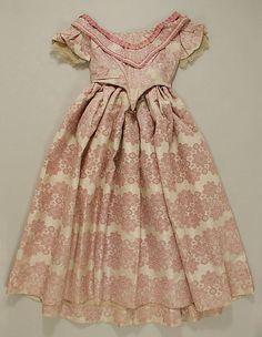 Evening dress, silk brocade, c. 1856, American. Metropolitan Museum of Art accession no. 1979.346.74a–c