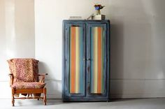 A gorgeous hand painted armoire is a colorful statement piece.