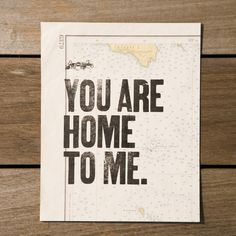 """CONSTELLATION & CO. (Seattle, WA) """"You Are Home To Me"""" Print $30.00 This sweet message is screen printed by hand on a reclaimed map (mostly from vintage Rand McNally atlases). Deliver to your long distance sweetheart or hang in your home as a love note to visitors! Measures 8 X 10 inches."""