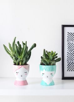 tiny succulents in egg-cup planters--drew faces with PORCELAIN PAINT PENS.