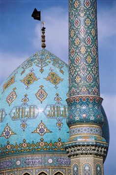 Qom, Iran: The minaret of Jamkaran Mosque, is graced with verses of the Koran written in classical Arabic and with exquisitely laid tile work