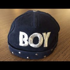 Suede genuine leather 'Boy London' Hat Suede genuine leather Boy London black hat that is adjustable (similar to a baseball cap without the brim) Decorative silver tone studs around the entire band. Embroidered BOY logo on the front. Gent worn a coue of times, great. Cool brand in Europe. Boy London Accessories Hats