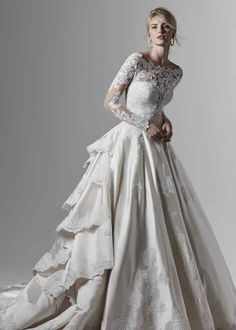 Wessex by Sottero & Midgley. This Elegance satin wedding dress features a gorgeous ballgown skirt, with delicate lace motifs adorning the tiered train, hemline, and bodice. Complete with illusion plunging neckline and half corset, half zipper closure. Gorgeous Wedding Dress, Best Wedding Dresses, Designer Wedding Dresses, Bridal Dresses, Gown Wedding, Lace Wedding, Modest Wedding, Mermaid Wedding, Cinderella Wedding