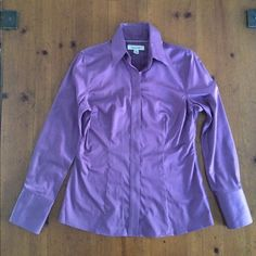 Banana Repub NEW brilliant Violet fitted shirt-Sz6 Never worn...This is such an amazing buttoned classic shirt. Not a button down with Guy's lapel buttons.  Top grade buttons chosen Shirt has stretch because fine cotton and 3% spandex. No iron.  Buttons are beneath front tab so not visible.  Cuffs are so sharp -  long 3 button cuff and one above cuff. A lot of tailoring in the back to achieve fitted effect.   Very professional.  And the color is stunning!    to HONOR MY MAN…
