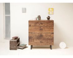 A four drawer chest made from reclaimed wood.