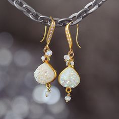These opalescent druzy, diamond and moonstone statement earrings are simply stunning. They will certainly add sparkle, style and statement to any outfit this season.  Perfect party earrings, these sensational gemstone drop earrings will help you breeze through all your evenings