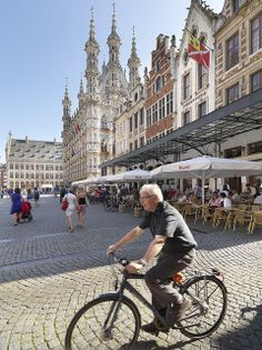 Cicyling in front of City Hall, Leuven, Belgium