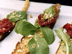 Oven-Dried-Tomato Bruschetta with Almonds and Arugula and other appetizers