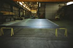 A steel floor frame chassis fabricated at our factory near Mittagong NSW for the Sydney 2000 Olympic Village. Olympic Village, Floor Framing, Ping Pong Table, Beams, Sydney, Flooring, Steel, Design, Home Decor