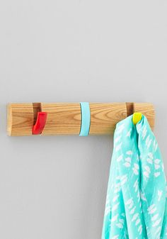 Wall hook that flips down when you need it, up when you don't! Primary colors red, yellow, and cyan blue #product_design