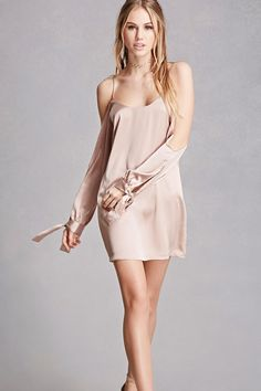 A satin dress featuring an open-shoulder design, scoop neck, scoop back, long sleeves with self-tie cuffs, a flared hem, and a concealed back zipper. This is an independent brand and not a Forever 21 branded item.