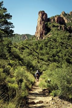 Fragrant with piñon pines, the Lost Mine Trail in the Chisos Basin in Texas features imposing stone formations and distant views of Mexico.