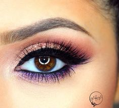 Beautiful peach smoky eye with a pop of color.