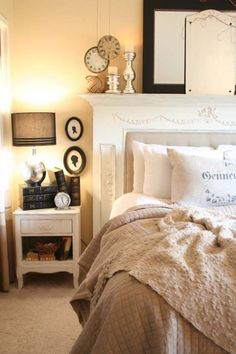 Creamy Dreamy French Style Bedroom. Love how they turned an old mantle in to a stunning headboard.