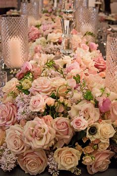 An amazing spectacle with masses of roses in soft pastel tones, anemones, sweet peas, tulips and lilac.