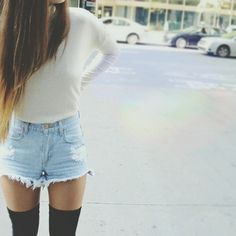 casual but stylish; white top and denim short shorts with long knee-high black socks