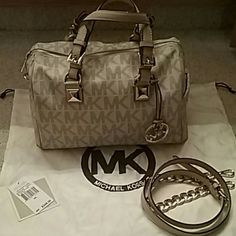 Michael Kors Michael Kors Medium Grayson in Vanilla bag in used very gently. NO STAINS interior. Scratches but not major on the gold hardware. ...Includes dust bag and extension strap  both brand new never been used. MICHAEL Michael Kors Bags Satchels