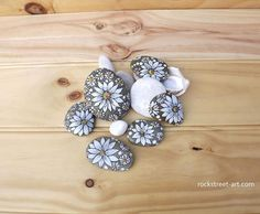 """158 Likes, 4 Comments - Christine Onward (@the_stunner_boutique) on Instagram: """"✨Rock flowers to lighten up your space✨#rockcollection #paintedflowers #beautifuldecoration…"""""""