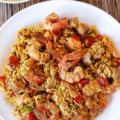 Spanish style rice dish - Mixed Paella with Chicken, Shrimp, Sausage, and Bell Peppers. Spiced up with smoked paprika, red chili powder and turmeric. I used to think that paella was a highly complicated dish Fish Dishes, Seafood Dishes, Seafood Recipes, Mexican Food Recipes, Chicken Recipes, Dinner Recipes, Cooking Recipes, Fish Recipes, Healthy Recipes