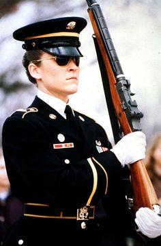 Army Sgt. Heather Johnsen, the first female assigned to stand guard at the Tomb of the Unknowns, is at attention at Arlington National Cemetery in 1996.