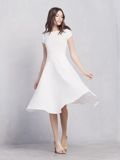 Reformation Caribou Dress in Ivory $138 - The Caribou Dress is simplicity at it's finest. No frills, all dreams. This is a jersey knit, short sleeve, mini dress. The bodice is fitted...