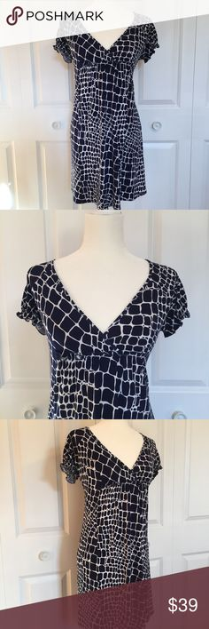 Laundry by Design navy giraffe print dress Laundry by Design navy giraffe print dress.  Size 4  Empire waist.  Short sleeves with elastic at cuffs  95% poly/ 5% spandex  15 inches under bust line 34 inches from shoulder seam to bottom hem Laundry by Design Dresses