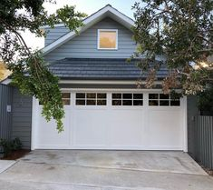 This particular industrial garage door is undeniably an interesting style technique. White Garage Doors, Electric Garage Doors, Garage Door Windows, Modern Garage Doors, Garage Door Styles, Garage Door Design, Industrial Garage Door, Sectional Garage Doors, Garage Door Makeover
