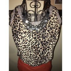 Cheetah Print Top Sheer cheetah racer back top. Striped contrasting detail around the neckline and back. American Rag Tops Blouses