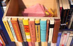 18 Ways to Upcycle Books via Brit + Co. - secret box for a bookshelf!