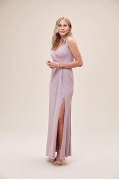 For a clean and modern wedding look, choose this stretch-crepe, V-neck bridesmaid dress. The lines of the form-fitting silhouette will fit seamlessly with the bride's sleek aesthetic while the flattering, wrap-style bodice and thigh-high slit add simple, sexy flair. Available in Sydney, Melbourne & Online. Brisbane, Melbourne, Sydney, Bridesmaids, Bridesmaid Dresses, Wedding Dresses, Wedding Looks, Wedding Vendors, Wrap Style