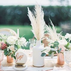 #inspiredby - This modern bohemian #weddingdecor is definitely after my California girl heart with its mix of pampas grass and metallics! Photo by@braedonflynn Event Design by@ladylibertyevents Floral Design by@stellabloomdesignsvia@greenweddingshoes