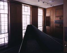 Richard Wilson's installation at the Saatchi Gallery in london. A room filled with oil - you enter the room on the walkway surrounded by the reflective substance - eery - cool