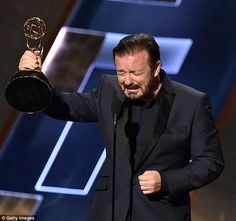 Prankster: Ricky Gervais pretended to win an Emmy on Sunday night as he presented the award for Outstanding Supporting Actor in a Comedy Series