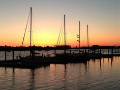 Sunset silhouettes ~ historic waterfront, Beaufort, North Carolina (photo by Betsy Cartier)....
