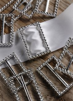 """Silver Faux Rhinestone Slip On Buckles 2.25"""" x 1.5"""" Rectangle  (10 pieces/pkg.) $3.99 pkg/4  pkgs $2.19 each These would work with the black or red ribbon around a candle jar representing Santa's belt!  Saveoncrafts!"""